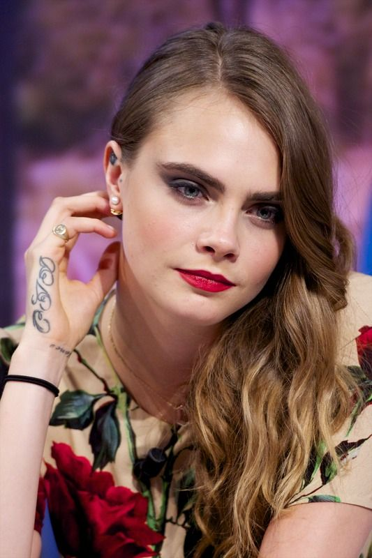 Cara Delevingne tattoo on hand sides