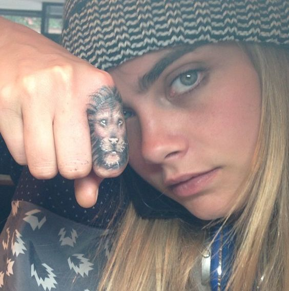 Cara Delevingne lion tattoo on finger