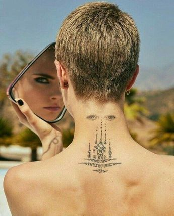 Cara Delevingne back tattoo