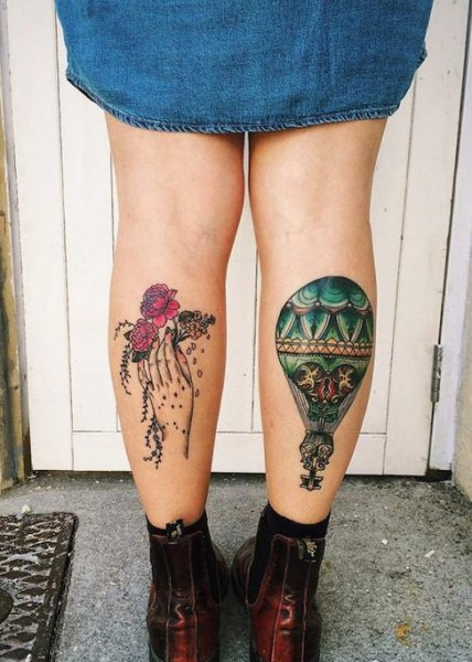 colorful flower tattoo on calf