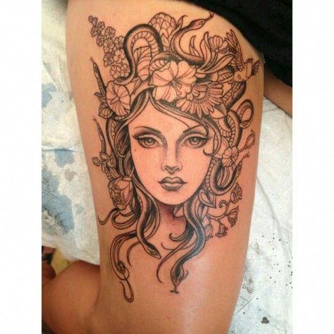Medusa Tattoos on thigh with flower