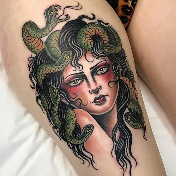 colorful medusa tattoo on thigh
