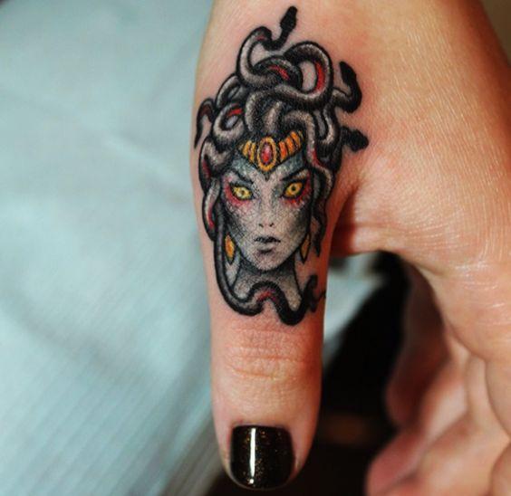 small medusa tattoo on thumb