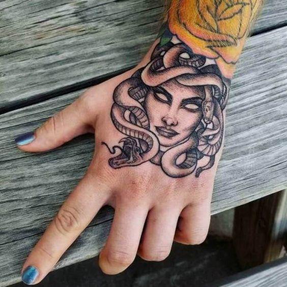 Medusa Tattoos on hand