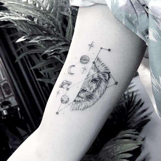lion tattoo on upper arm