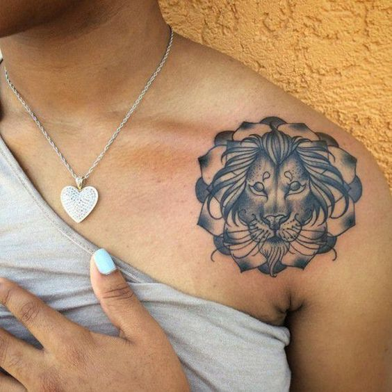 Circle lion tattoo on shoulder