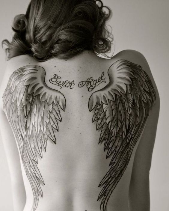 Angel wings tattoo on back for women