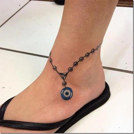 Bracelet tattoos on ankle
