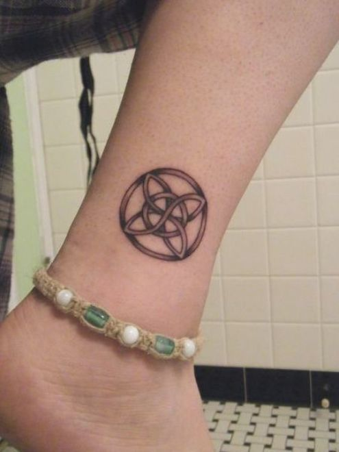 Celtic symbol tattoos on leg