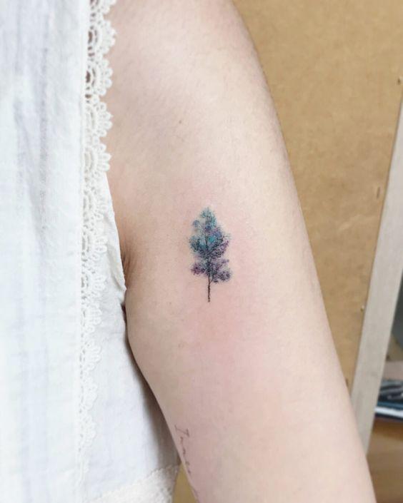 Tree tattoos on upper arm