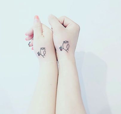 Owl tattoo on wrist