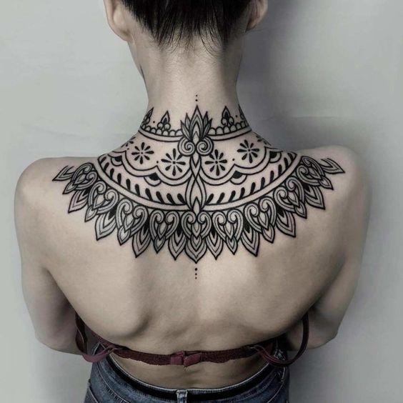 unique design upper back tattoo