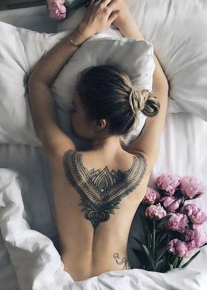 upper back flower tattoo